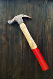 Old hammer on wooden background Stock Photography