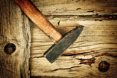 Old hammer on the wooden planks Stock Photography