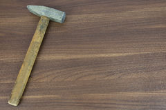 Old hammer on a wooden surface Stock Image