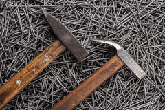 Old hammers and nails on table Stock Images