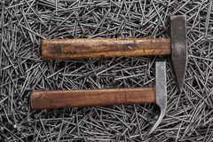 Old hammers and nails on table Royalty Free Stock Photography