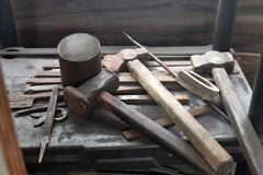 Blacksmith workshop tools, hammers in barn stock image