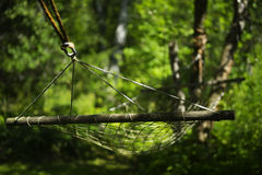 Old hammock. Hanging in a garden Stock Images
