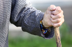 Old hand. Old tired woman's hand holding wooden stick Stock Image