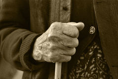 Old hand. Old woman resting in a crutch Stock Photography