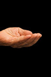 The old hand begging on the black Royalty Free Stock Photo