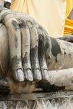 Old hand of buddha statue Stock Photo