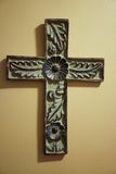 Old hand carved wooden cross with floral design. Heavy handcrafted wooden cross fits well with folksy home decor Stock Image