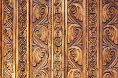 Old hand-carved wooden pattern on a monastery door Stock Photo