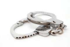 Old hand cuffs. Closeup of old hand cuffs Royalty Free Stock Photo
