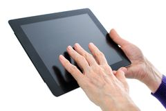 Old hand on  digital tablet. Old wrinkled hand touch display tablet Stock Photos