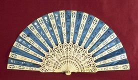 Old hand fan. Old blue and white ivory hand fan Royalty Free Stock Photos