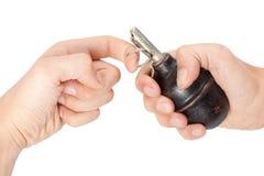 Old hand grenade in a hand. Old hand grenade in a man's hand Stock Photos