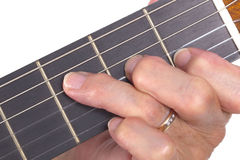 Old hand and guitar isolated Stock Images