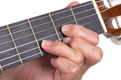 Old hand and guitar isolated Royalty Free Stock Images