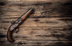 Old hand gun on wod. Very old hand gun on wooden planks, shot from upper view Stock Images
