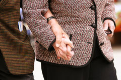 Old hand in hand closeup. Old hand supporting old hand-helping elderly people Royalty Free Stock Images