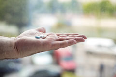 Old hand holding pills Stock Photography