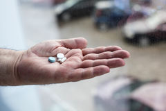 Old hand holding pills Royalty Free Stock Image