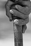 Old hand holding a stick close up Stock Images