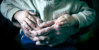 Old hand holding stock photography