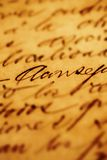 Old Hand Lettering. Old handwriting on an aged paper royalty free stock image