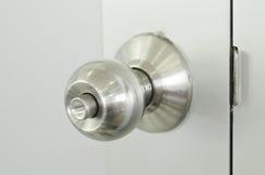 Old hand lock. Old stanless hand lock with door Stock Images