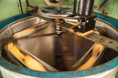 Old Hand-made automated Honey Extractor Stock Image