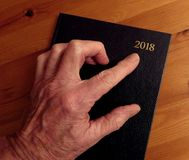 Old hand, new year, pointing Stock Image