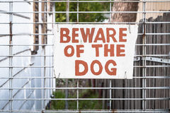Old Hand Painted Cream and Red Sign: BEWARE OF THE DOG Royalty Free Stock Images