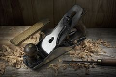 Old hand plane on carpenter workbench stock photos
