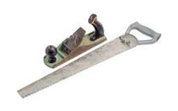 Old hand plane and crosscut hand saw Royalty Free Stock Photo