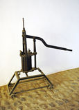 Old hand pump for transferring the wine in the cellar Royalty Free Stock Image