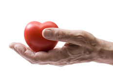 Old hand with red heart stock photo