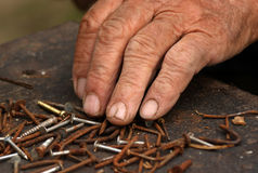 Old hand sorted nails and screws Royalty Free Stock Photos