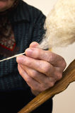 Old hand spinning wool Stock Image
