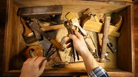 Old hand tool in a wooden chest. Retro tool. Rusty pliers, hammer, file, saw. Old wooden tool box.. Old hand tool in a wooden chest. Retro tool. Rusty pliers stock footage