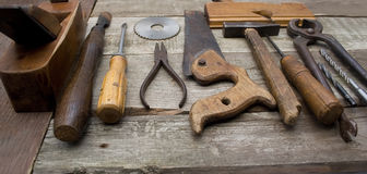 Old hand tools in a row. Royalty Free Stock Photo