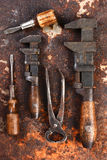 Old Hand Tools on Rusty Surface Royalty Free Stock Image