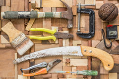 Old hand tools on wood texture. Stock Photos