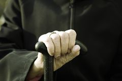 Old hand with walking stick Royalty Free Stock Images