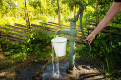 Old hand water pump outside in the garden Stock Image