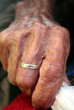 Old hand with the wedding ring Stock Images