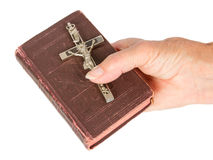 Old hand (woman) holding a very old bible Stock Image