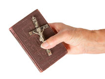 Old hand (woman) holding a very old bible Royalty Free Stock Image