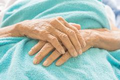 Old Hand women on bed patient royalty free stock photo