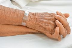 Old Hand women on bed patient royalty free stock image