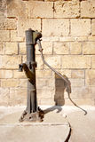 An old hand worked water pump in Greece Stock Photo