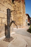An old hand worked water pump in Greece Royalty Free Stock Image