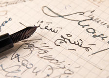 Old hand-written with Arabic letters. Close up of old hand-written with Arabic letters Royalty Free Stock Photography